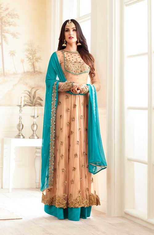 COLOR : Apricot & Blue FABRIC : Top - Net, Bottom - Santoon, Inner - Santoon,Dupatta - Chiffon WORK : Heavy Resham & Zari Embroidery, Motifs, Stones, Sequins, Lace OCCASION : Wedding, Reception, Party Wear READY-TO-WEAR : NoSTITCHING : Available as semi-stitched fabric, can be stitched using standard size option (+$20). Note: There might be a slight color variation due to lighting and flash used during photoshoot. The bright shade seen is the best closer view of fabric&#...