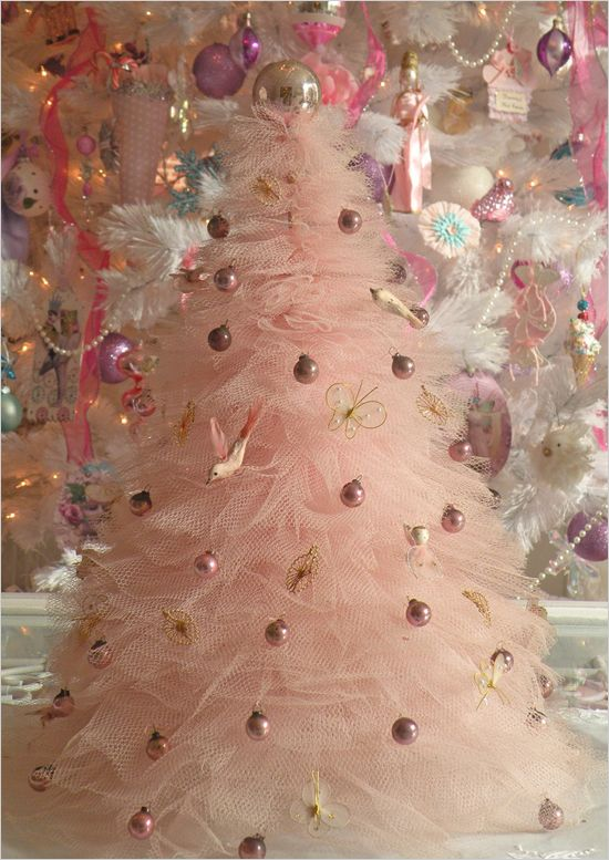 Pink tulle tree? 17 Alternative Christmas Trees. Which one would you choose or will you stick with the traditional? #christmastreeideas www.weddingchicks.com/17-alternative-christmas-trees/