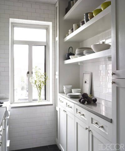 The Best Kitchens of 2014 - There's nothing cramped about this film noir-inspired studio kitchen: The custom countertop is painted a blissful white (Benjamin Moore's Dove Wing) and topped with Caesarstone countertop.