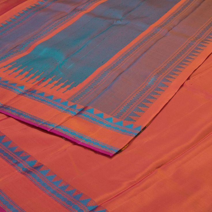 Elegant bhutta designs adorn this beautiful peach pink soft silk sari.