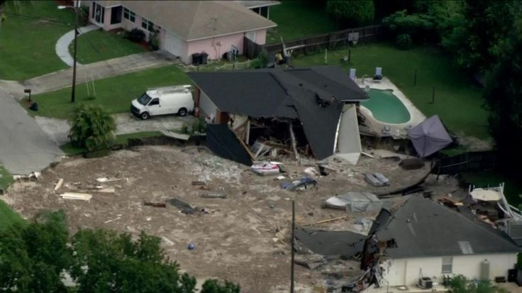 July 2017 A sinkhole swallowed two houses in Land O' Lakes, FLa residential area about 20 miles north of Tampa. The sinkhole, estimated to be 250 feet by 225 feet wide &50 feet deep, is full of water & not draining because of debris. It appears to be full of household chemicals & septic tank parts. The neighborhood uses septic tanks, not a sewer system -- a worry because the sinkhole could expand to connect to a nearby lake. 3-4 septic tanks will start merging with the lake. (GROSS!)