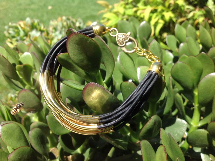 Black Leather with gold tube beads.