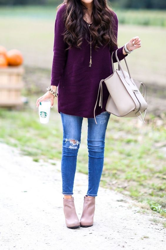 ripped blue jeans, a purple long sweater and blush boots