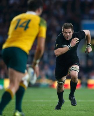 All Blacks captain Richie McCaw chases down a kick during the final.