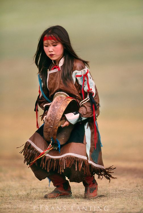 Young woman dancing in tribal dress, Ulaanbaatar, Mongolia