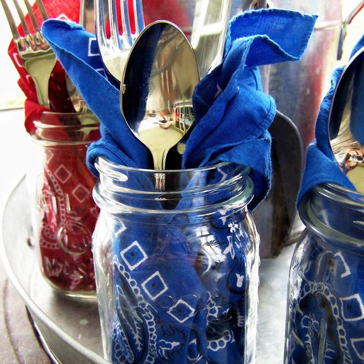 Mason jar with bandana for napkin, and silverware in it. Great all in one for parties!