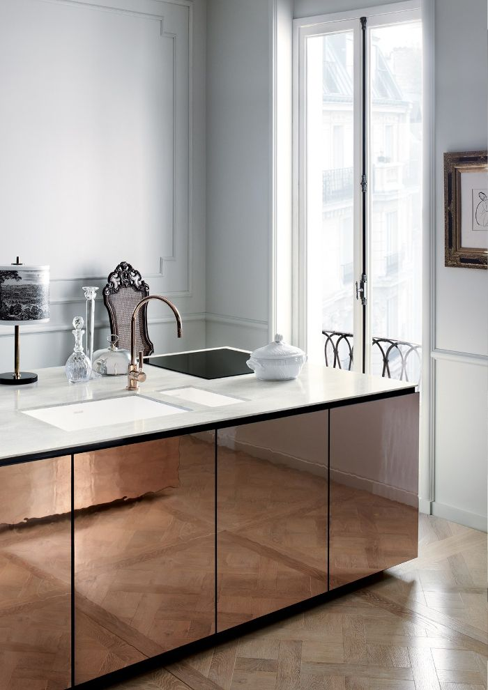 Amazing kitchen with copper tap and doors and marble tops, plus herringbone parquet - wow!