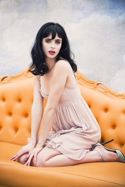Black hair and bangs perfectly coiffed.  Krysten Ritter