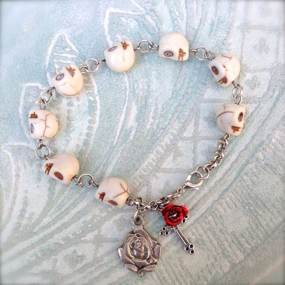 Ghede/Day of the dead bracelet made from turquoise skulls and a rose medallion
