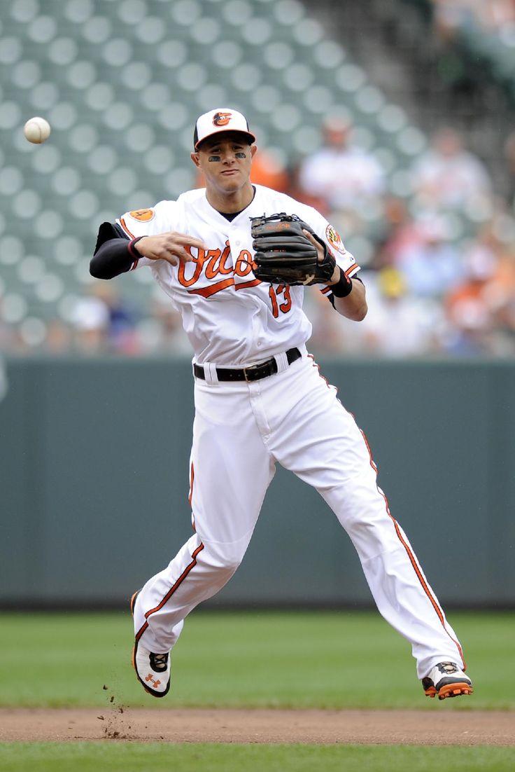 Baltimore Orioles third baseman Manny Machado throws to