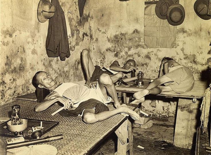 Old Kolkata, 1945. A little snooping in Chinatown will turn up the little opium dens stuck down an alley (not recommended without police escort). Actually, the smokers shown in this picture do it legally. Each den is licensed for so many pipes. Each pipe costs a rupee, a phial of opium five rupees. The average smoker consumes a phial a day and there are about 186 pipes licensed in Calcutta.