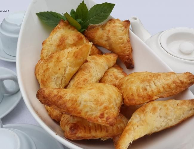 Cheese and Pastirma turnovers.   These freshly baked flaky triangles are filled with goodness of cheese and pastirma.   image 1