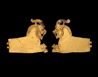 A PAIR OF ACHAEMENID GOLD LION-GRIFFIN ATTACHMENTS 5TH-4TH CENTURY B.C.