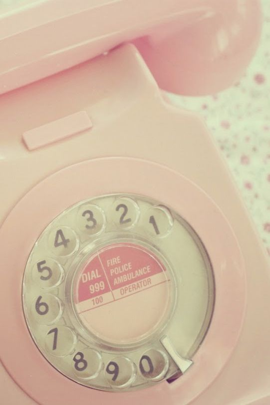 Pink rotary phone - UK. See the 999 emergency listing? Like that didn't add time to the call waiting for the rotary to return! Oof.