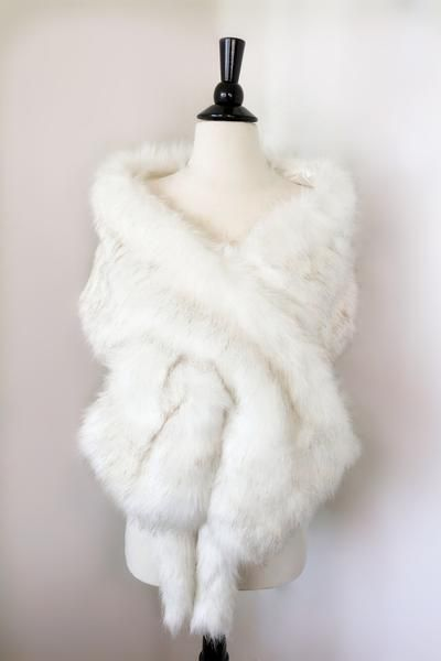 High quality faux fur bridal wrap, perfect for brides, bridesmaids and events wears. Three ways of wearing the fur shawl:  * Wear it on your arms  * Wear it like the pictures (put one end through the other end)  * Wear it with hooks to close in front.61 x 10 inches: Suggest size US 0 - 6 (sold out)65 x 11 inches Suggest size US 6 - 10 69 x 12 inches Suggest Size US 10 - 16+