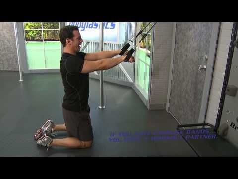 """Blake Kassel of Liveexercise.com demonstrates the """"straight arm lat pulldown"""" using fitness tubes.   Go to http://www.liveexercise.com for more great exercises and FREE live fitness bands workouts. The straight arm lat pulldown is a super effective exercise to work  the large muscles on the back the Latissimus Dorsi. This exercise closely mimics..."""