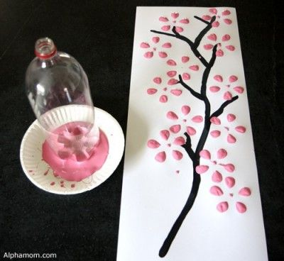 Painted Cherry Blossom tree - blossom printed with an empty drinks bottle on a painted tree trunk