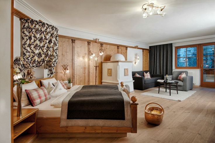 Enzian Suite, very quietly positioned suite with natural timber floors, spacious living and sleeping area, cosy seating area, tiled stove, flat-screen TV, W-LAN, radio, and Nespresso machine ...   http://www.alpenschloessl.com/en/rooms-prices/hotel-zimmer-11099-enzian-suite.html