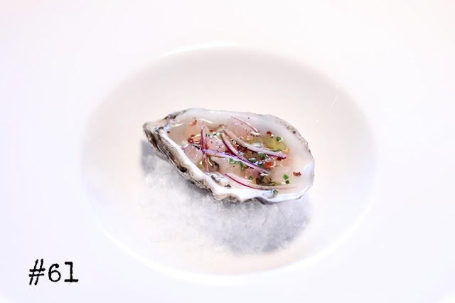 Oyster with grapefruit, onion, chili & chives