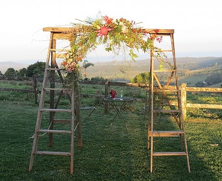 Ladder arbour for a backdrop at a vintage wedding or party . Add a lovely floral display and you have a show stopper . To find this type of look with twin ladders available ya mysweeteventhire .melbourne