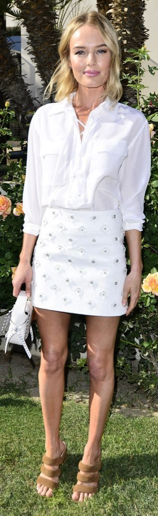 Kate Bosworth totally owns her all-white look with the Coach Rivets Dakotah Bag by her side.