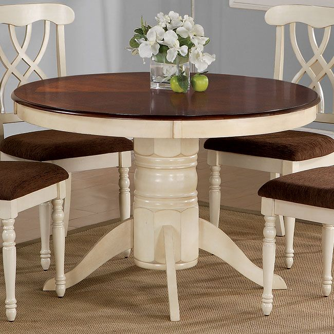 The Cameron Round Dining Table features a simple rustic charm that you are sure to fall in love with. The thick pedestal base is finished in a light buttermilk for a cottage style look. The smooth, round table surface is finished in a contrasting dark cherry for a beautiful two-tone color palette. Pair with the matching side chairs for the complete set.