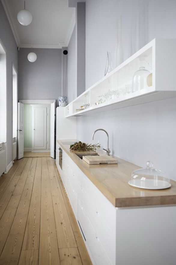 KML Design. I like the simplicity, the lavendar/grey walls and the wide plank flooring.