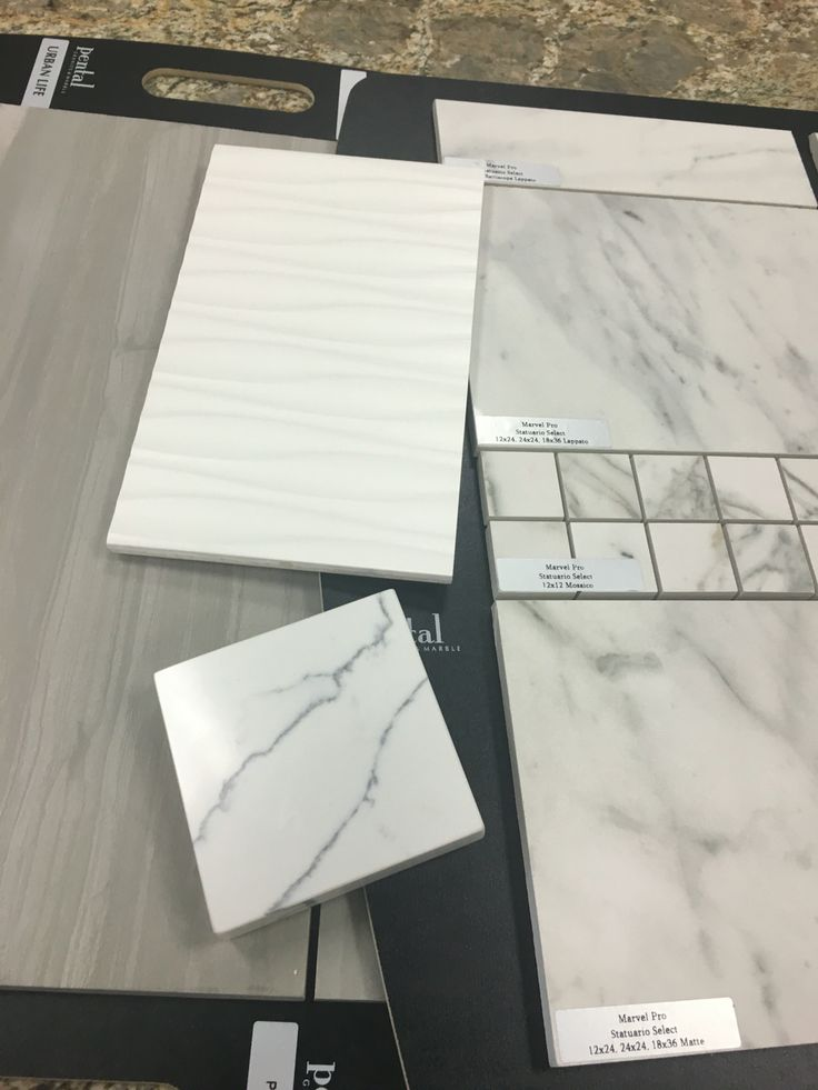 "Grey Tile Foors/ White Tile for bathtub face/ ""Marble"" large Tile for shower and Fireplace/ Quartz countertops in Kitchen/Master Bath/Guest Bath/ Laundry Room"