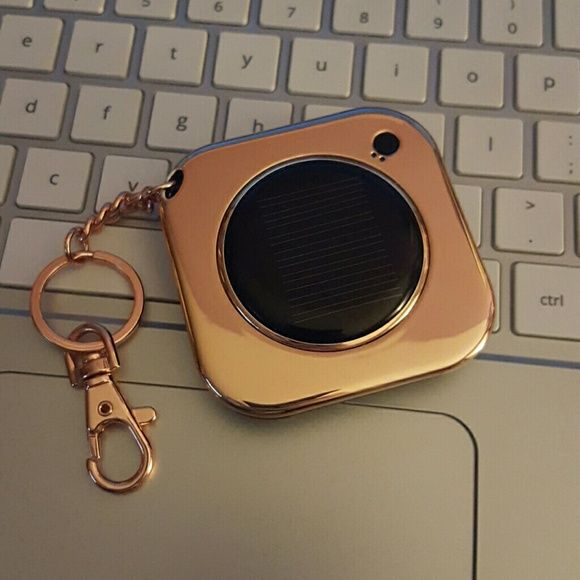 Rose Gold Solar Charger Solar Charger in the color rose gold with Keychain. Compatible with iPhone 6/6 plus/5/5s/5sc and all samsung phones. Rechargeable lithium battery w/5-6 hours talk time and charges in 1 hr via USB port. Perfect for your purse :) MixBin Accessories