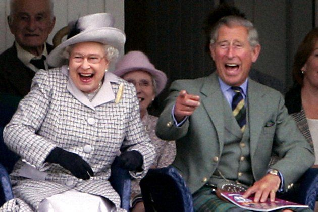 02/09/06 Queen Elizabeth II and the Prince of Wales share a laugh at the Braemar Highland Games.