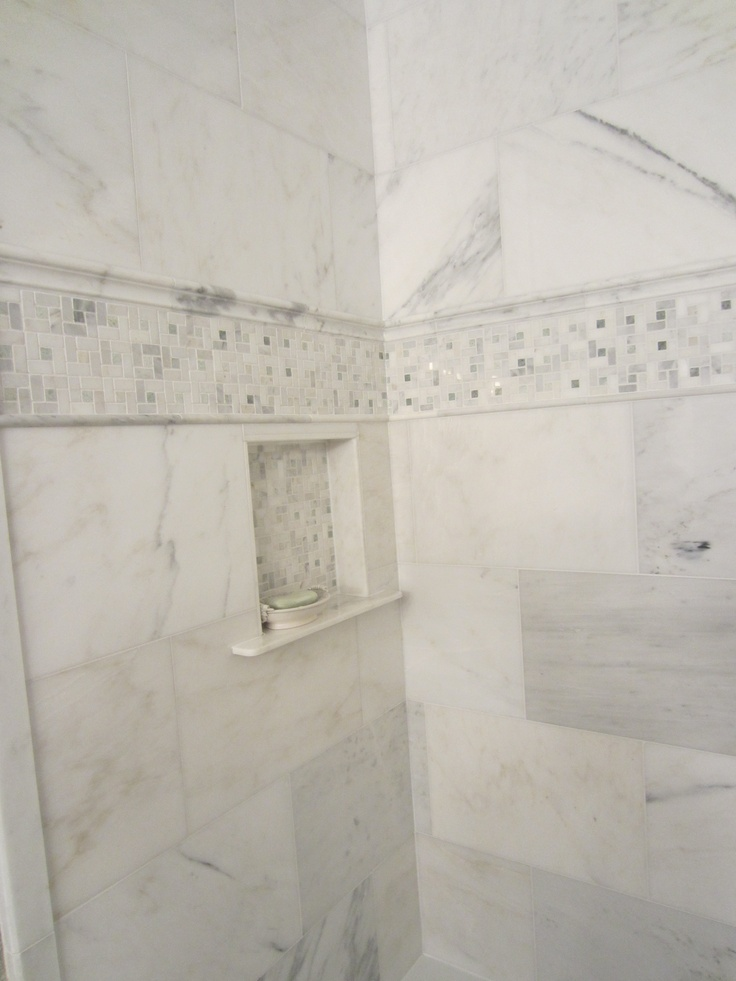 Carrara Mable tiles with decorative accent and built-in niche