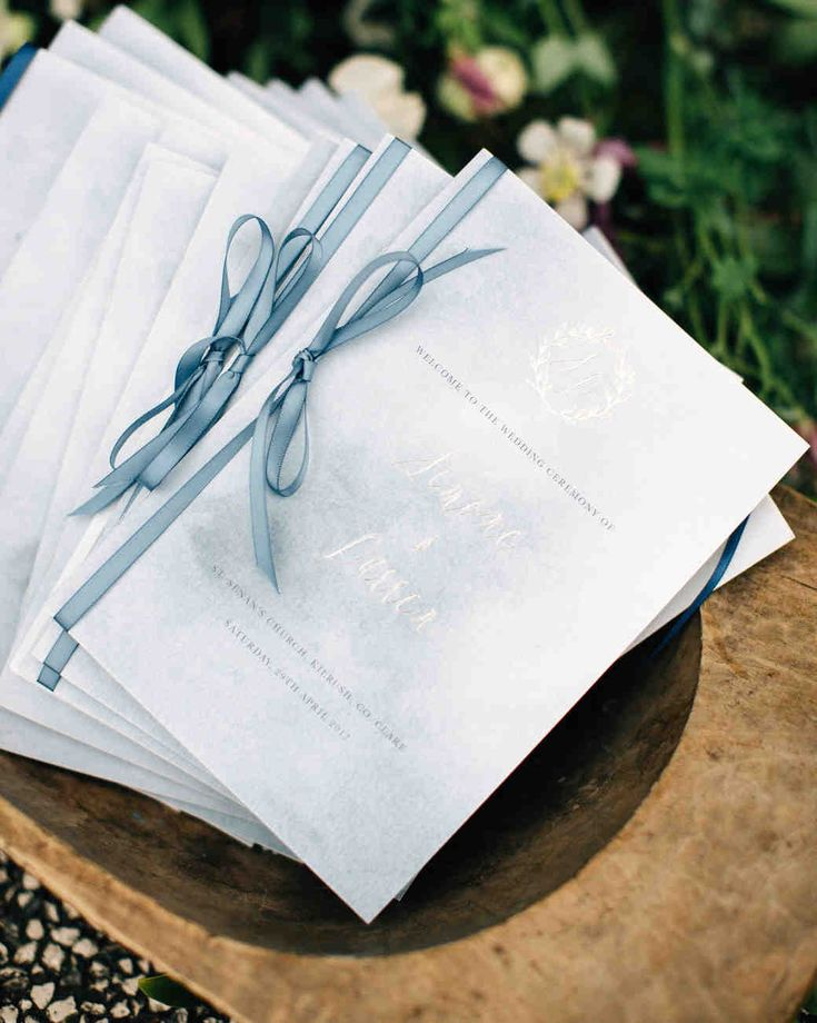 A Wedding Inspired by the Coast of Ireland | Martha Stewart Weddings - Silver-foil monograms topped the cover of the ceremony booklets.