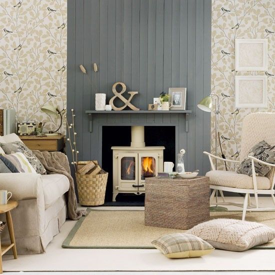 Dark grey touches and feature wallpaper is a great decorating idea for taking this classic country-style living room in a more elegant direction.
