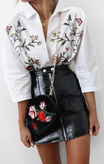 embroidered top. leather mini skirt.