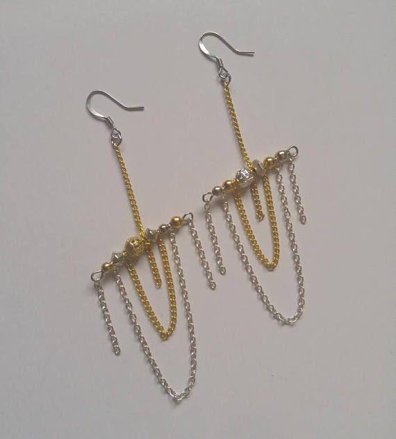 BALANCING ACT mixed metal dangle earrings