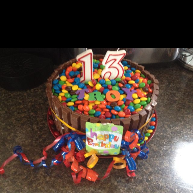 Troy's 13th birthday cake with color blast layers inside!