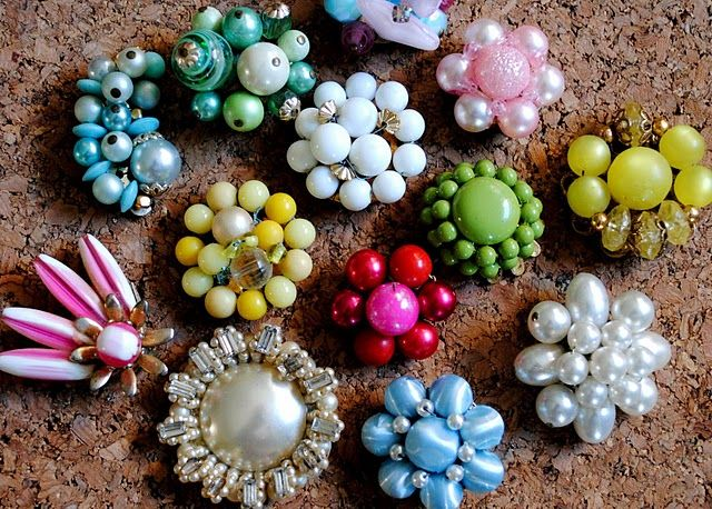 Make cork board pins with costume jewelry from thrift store.