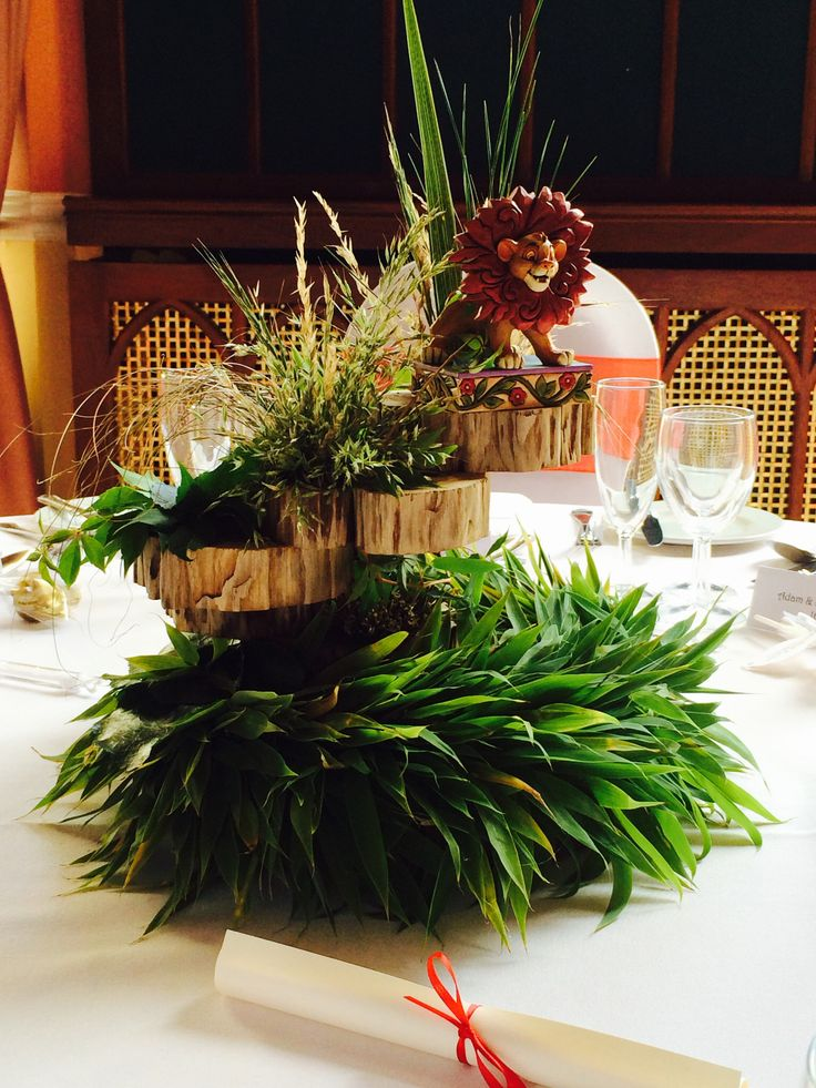 Wedding ! Lion king table arrangement on one of the theme table decoration at studley castle