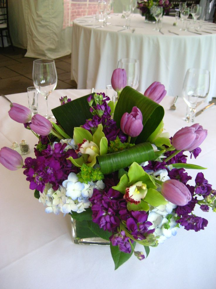 Such fun purple centerpieces with stock tulips green