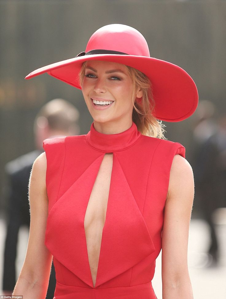 Hats off to her! She doubled upon the fiery hue by wearing a matching red hatinator by Melissa Jackson