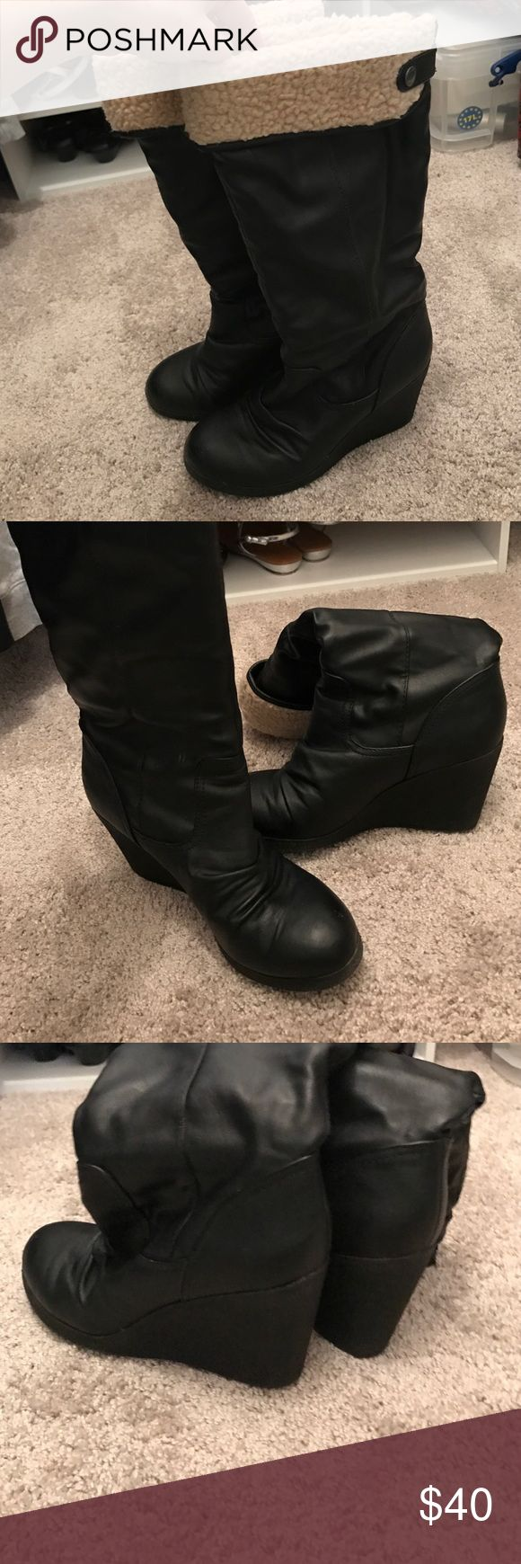 Victoria Secret black wedge boot Super cute and comfortable black wedge boot with sheep wool cuff. Purchased from Victoria Secret catalog when they used to sell awesome shoes and coats. Excellent condition!! Victoria's Secret Shoes Winter & Rain Boots