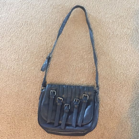 Black Satchel/ Crossbody Adjustable straps. Has tares on the straps as pictured. Other than that it has no other flaws. It's clean inside and out. Bags Satchels