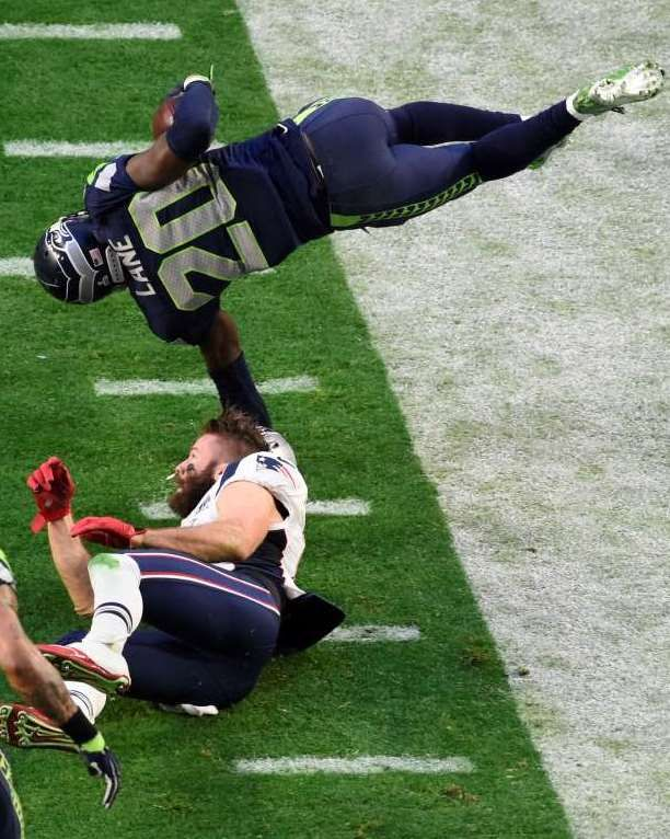 Seattle Seahawks cornerback Jeremy Lane (20) is knocked airborne by New England Patriots wide receiver Julian Edelman (11) after a first quarter interception in Super Bowl XLIX. Lane was injured on the play.
