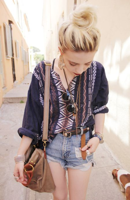 indie look: ripped shorts, pattern oversized blouse, shapeless shoulder bag, lennon glasses and bun