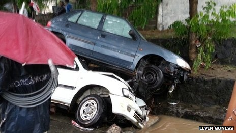 "Deadly floods hit Mauritius capital-(Wrecked cars)  Port Louis - 30 March, 2013..The people blamed the authorities, so of course Prime Minister Navin Rangoolam blamed it on ""climate change""..when in fact the heavens poured down152mm (6in) of rain fell in less than an hour, 70mm less than the March average. Some kept Sabbath because it was raining so heavily..6 bodies recovered from subway & 2 from underground car park. At least 11 died who ventured out this day.."