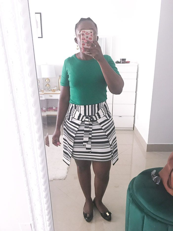 summer work outfit with green top and striped skirt