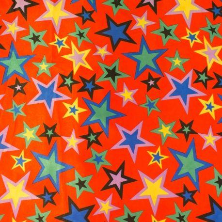 Satin polyester étoiles multicolores sur fond rouge