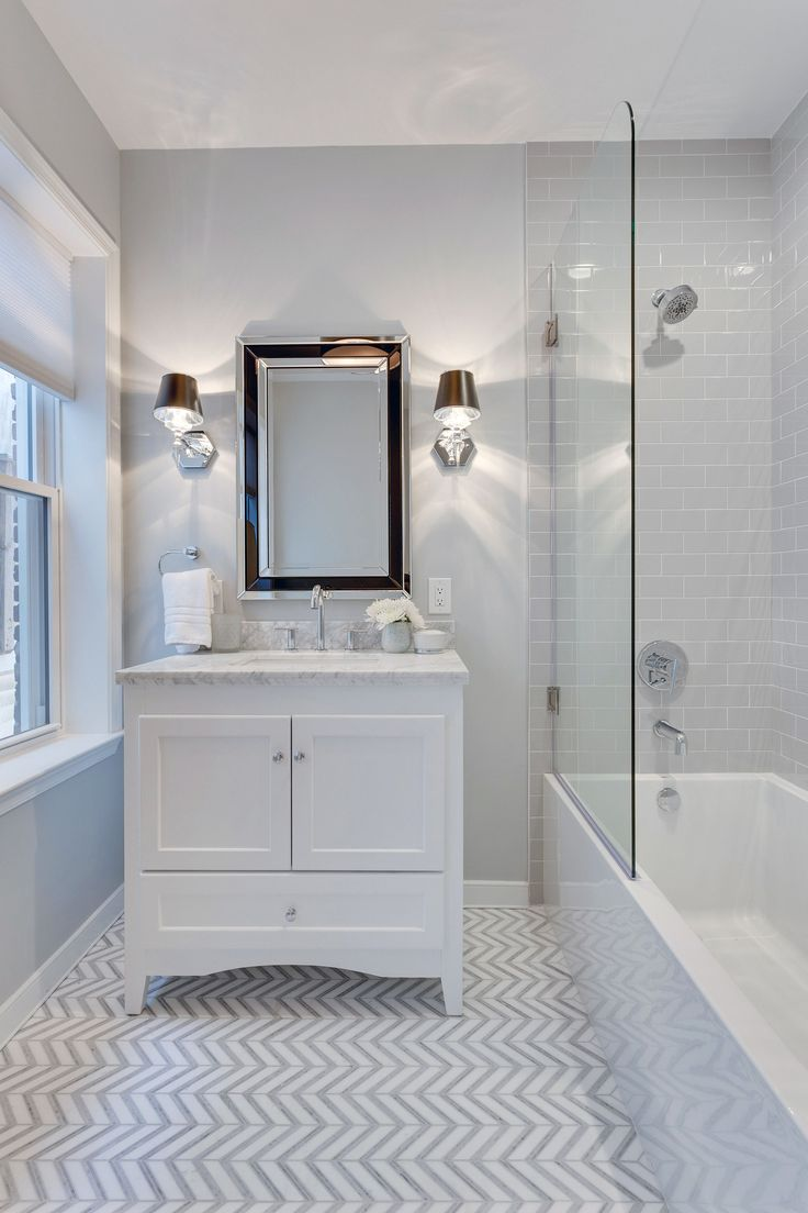 Gray And White Bathroom With Chevron Marble Floor Tile