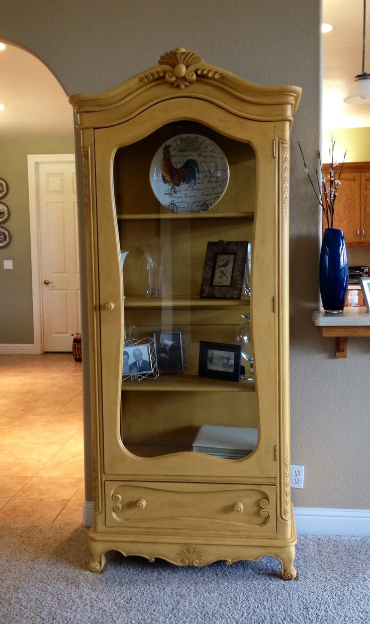 I love this one too. and I would leave it this color. Yellow chalk paint curio cabinet