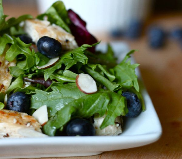 Grilled Chicken and Blueberry Salad = 5c mixed greens 1c blueberries ¼c slivered almonds 2c cubed chicken breasts, cooked Dressing¼c olive oil ¼c apple cider vinegar ¼c blueberries 2 T honey s/p =In a lg bowl, toss the greens, blueberries, almonds, and chicken breasts until well mixed. For the salad dressing, combine the olive oil, apple cider vinegar, blueberries, and honey in a blender. Blend until smooth. Add salt and pepper to taste.